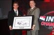Sage Karam is presented a sketch of his winning car as the 2013 Firestone Indy Lights champion -- Photo by: Chris Jones