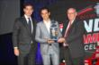 Helio Castroneves accepts his second place championship driver award from Derrick Walker at the 2013 INDYCAR Championship Celebration -- Photo by: Chris Jones
