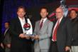 Derrick Walker presents the Championship Team Manager award to Scott Harner and Barry Wanser with Target Chip Ganassi Racing -- Photo by: Chris Jones