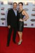 Tony and Lauren Kanaan walk the red carpet at the 2013 INDYCAR Championship Celebration -- Photo by: Chris Jones