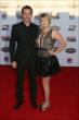 Simon Pagenaud and his girlfriend walk the red carpet at the 2013 INDYCAR Championship Celebration -- Photo by: Chris Jones