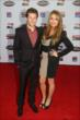 Marco Andretti and his girlfriend walk the red carpet at the 2013 INDYCAR Championship Celebration -- Photo by: Chris Jones