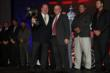 Chip Ganassi accepts the championship team owner's trophy for the 2013 IZOD IndyCar Series championship -- Photo by: Chris Jones