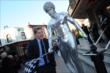 Josef Newgarden interacts with a live statue outside the Globe Theater at Universal Studios Hollywood prior to the 2013 INDYCAR Championship Celebration -- Photo by: Chris Owens