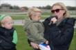 Susie Wheldon addresses the crowd before the start of the Dan Wheldon Pro-Am Karting Classic -- Photo by: Chris Owens