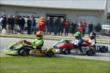 James Hinchcliffe, Conor Daly, and Zach Veach mix things up during the Dan Wheldon Pro-Am Karting Classic -- Photo by: Chris Owens
