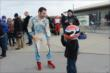Simon Pagenaud lets a young fan try on his helmet at the Dan Wheldon Pro-Am Karting Classic -- Photo by: Chris Owens