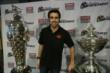 Dario Franchitti poses with the Borg-Warner Trophy and the Astor Cup following his retirement press conference at the Target Chip Ganassi Racing offices -- Photo by: Chris Jones