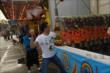 Mikhail Aleshin tosses a baseball at an Indiana State Fair carnival game -- Photo by: Chris Jones