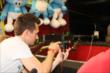 Mikhail Aleshin takes aim while playing an Indiana State Fair carnival game -- Photo by: Chris Jones