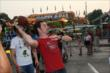 Simon Pagenaud tosses a football while playing an Indiana State Fair carnival game -- Photo by: Chris Jones