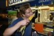 Josef Newgarden chows down on a classic Indiana State Fair staple, a grilled corn-on-the-cob -- Photo by: Chris Jones