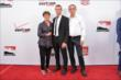 Sebastien Bourdais and his guests on the red carpet prior to the 2014 INDYCAR Championship Celebration