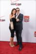 Helio Castroneves and Adriana Henao on the red carpet prior to the 2014 INDYCAR Championship Celebration