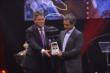 Juan Pablo Montoya is presented the 2014 Fan Favorite Award during the 2014 INDYCAR Championship Celebration -- Photo by: Chris Owens
