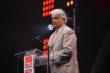 INDYCAR CEO Mark Miles at the podium during the 2014 INDYCAR Championship Celebration -- Photo by: Chris Owens