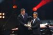 Juan Pablo Montoya accepts the 2014 Fan Favorite Driver Award during the 2014 INDYCAR Championship Celebration -- Photo by: Chris Jones