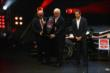 Roger Penske and Helio Castroneves receive the Verizon IndyCar Series 2nd Place Trophy at the 2014 Championship Celebration -- Photo by: Chris Jones