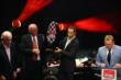 Helio Castroneves receives the Verizon IndyCar Series 2nd Place Trophy at the 2014 Championship Celebration at Club Nokia -- Photo by: Chris Jones