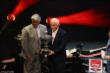 Roger Penske receives the Championship Team Owner's Mini-Astor Cup trophy from INDYCAR CEO Mark Miles at the 2014 Championship Celebration -- Photo by: Chris Jones