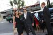 Helio Castroneves and Adriana Henao exit their limo as they arrive to the 2014 INDYCAR Championship Celebration -- Photo by: Joe Skibinski