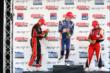 Champagne sprays on the podium at Baltimore -- Photo by: Chris Jones