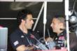 Tony Kanaan and Dario Franchitti chat in the Target Chip Ganassi Racing pitstand at Mid-Ohio -- Photo by: Chris Jones