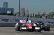 Takuma Sato and Tony Kanaan exit Turn 2 during practice for the Chevrolet Dual In Detroit -- Photo by: Chris Owens