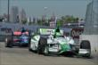 Carlos Munoz and Graham Rahal exit Turn 2 during practice for the Chevrolet Dual In Detroit -- Photo by: Chris Owens