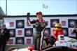 Helio Castroneves celebrates his Verizon P1 Award for winning the pole for Race 1 of the Chevrolet Indy Dual in Detroit -- Photo by: Chris Jones