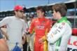 Fellow Colombians Carlos Huertas, Sebastian Saavedra, and Carlos Munoz chat during pre-race festivities at Belle Isle -- Photo by: Chris Owens