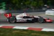 Helio Castroneves begins his Turn 3 exit during Race 1 of the Chevrolet Indy Dual in Detroit -- Photo by: Chris Owens