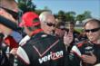 Roger Penske congratulates Will Power -- Photo by: Chris Owens