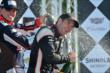 Graham Rahal and Will Power spray the champagne on the podium for Race 1 of the Chevrolet Indy Dual in Detroit -- Photo by: Chris Owens