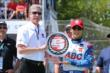 Takuma Sato receives the Verizon P1 Award for winning the pole position for Race 2 of the Chevrolet Indy Dual in Detroit -- Photo by: Chris Jones