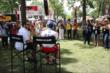 Takuma Sato chats during a Q&A in the INDYCAR Fan Village -- Photo by: Chris Jones