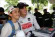 Graham Rahal poses for a photo during the INDYCAR Fan Village Autograph Session -- Photo by: Chris Jones