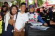 Takuma Sato poses for a photo during the INDYCAR autograph session in Belle Isle -- Photo by: Chris Jones