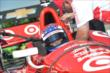 Scott Dixon gets strapped in prior to qualifications for Race 2 of the Chevrolet Indy Dual in Detroit -- Photo by: Chris Owens