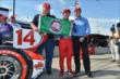Takuma Sato, A.J. Foyt and Larry Foyt with the Verizon P1 Award flag for their pole for Race 2 of the Chevrolet Indy Dual in Detroit -- Photo by: Chris Owens