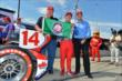 Takuma Sato, A.J. Foyt, and Larry Foyt with the Verizon P1 Award flag for winning the pole for Race 2 of the Chevrolet Indy Dual in Detroit -- Photo by: Chris Owens