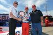Takuma Sato is awarded the Verizon P1 Award for winning the pole for Race 2 of the Chevrolet Indy Dual in Detroit -- Photo by: Chris Owens