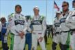 Sebastien Bourdais with his crew members during pre-race festivities -- Photo by: Chris Owens