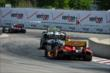 The field snakes through Turns 1 & 2 during Race 2 of the Chevrolet Indy Dual in Detroit -- Photo by: Chris Owens