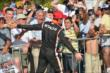 Helio Castroneves gives high-fives to the fans after winning Race 2 of the Chevrolet Indy Dual in Detroit -- Photo by: Chris Owens