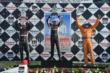 Helio Castroneves, Will Power, and Charlie Kimball hoist their trophies for Race 2 of the Chevrolet Indy Dual in Detroit -- Photo by: Chris Owens