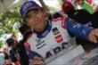 Takuma Sato signs autographs in the INDYCAR Fan Village at Belle Isle -- Photo by: Joe Skibinski