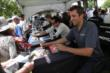 Dale Coyne Racing teammates Justin Wilson and Carlos Huertas sign autographs in the INDYCAR Fan Village -- Photo by: Joe Skibinski