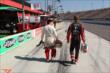 Gabby Chaves and Sage Karam walk down pit lane at Auto Club Speedway. -- Photo by: Chris Jones