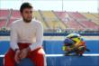 Jorge Goncalves takes a moment prior to qualifications at Auto Club Speedway -- Photo by: Chris Jones